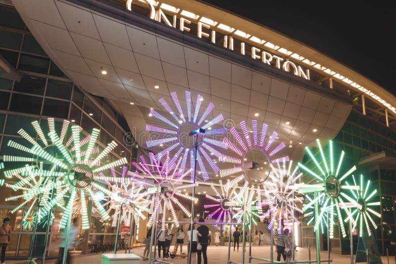 Kwitnie zegar przed Jeden Fullerton dla Singapur iLight 2019 zdjęcia royalty free