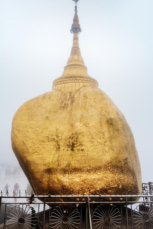The Kyaikhtiyo Pagoda or Golden Rock in a foggy day - kyaikhtiyo, kyaiktiyo - Burma - Myanmar. The Kyaikhtiyo Pagoda or Golden Rock is one of the most sacred stock images