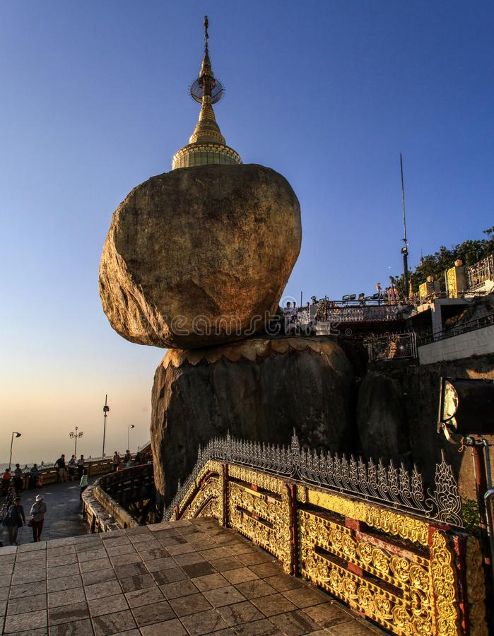 Kyaiktiyo Pagoda also known as Golden Rock at sundown, Mon State, Myanmar. Kyaiktiyo Pagoda also known as Golden Rock is a well-known Buddhist pilgrimage site in stock photography