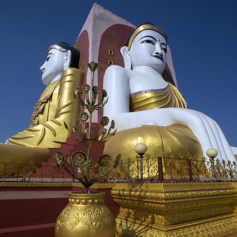 Kyeik Pun Pagoda - Bago - Myanmar (Burma). The Kyeik Pun Pagoda in Bago in Myanmar. This pagoda has four giant Buddha statues facing the four points of the stock images