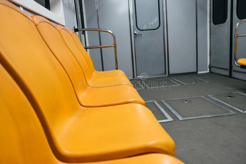 Kyiv metro wagon interior with no people. And orange seats stock photography