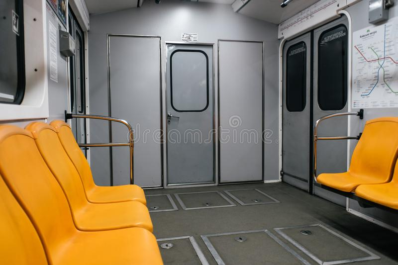 Kyiv metro wagon interior with no people. And orange seats royalty free stock photo