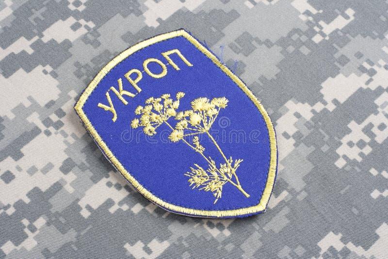KYIV UKRAINA - Juli, 16, 2015 Inofficiellt enhetligt emblem för Ukraina armé arkivbilder