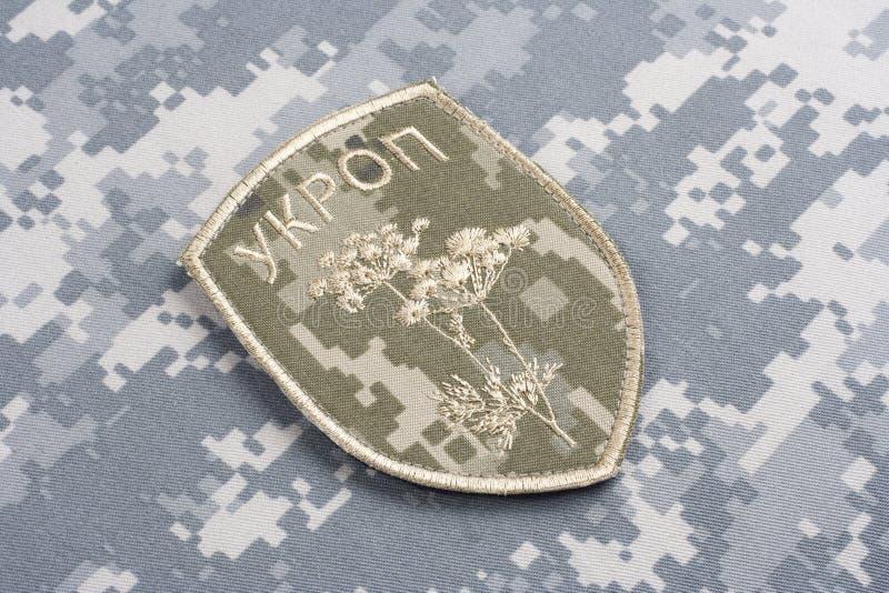 KYIV UKRAINA - Juli, 16, 2015 Inofficiellt enhetligt emblem för Ukraina armé arkivbild