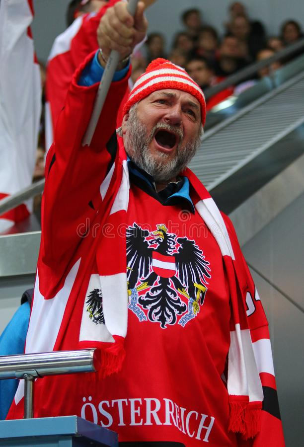 Ice Hockey 2017 World Championship Div 1 in Kyiv, Ukraine. KYIV, UKRAINE - APRIL 24, 2017: Austrian fan shows his support during IIHF 2017 Ice Hockey World royalty free stock images