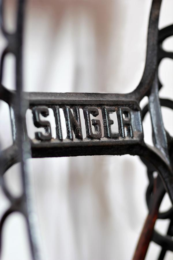 Close up of a metal Singer logo on an old american vintage manual sewing machine. Illustrative edi stock image
