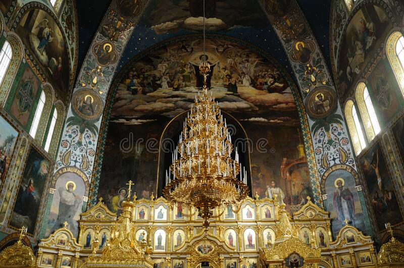 The interior of the Mykolayiv Cathedral is an Orthodox church in Kyiv. Kyiv, Ukraine - April 24, 2019; The iconostasis of the Mykolayiv Cathedral is an Orthodox royalty free stock photos