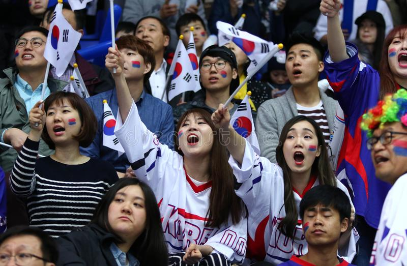 Ice Hockey 2017 World Championship Div 1A in Kyiv, Ukraine. KYIV, UKRAINE - APRIL 28, 2017: South Korean fans show their support during IIHF 2017 Ice Hockey stock images