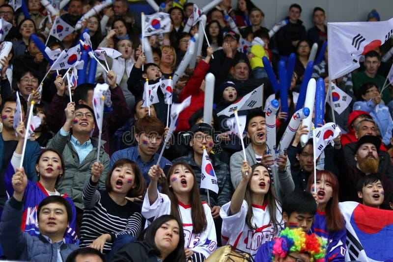Ice Hockey 2017 World Championship Div 1A in Kyiv, Ukraine. KYIV, UKRAINE - APRIL 28, 2017: South Korean fans show their support during IIHF 2017 Ice Hockey stock image