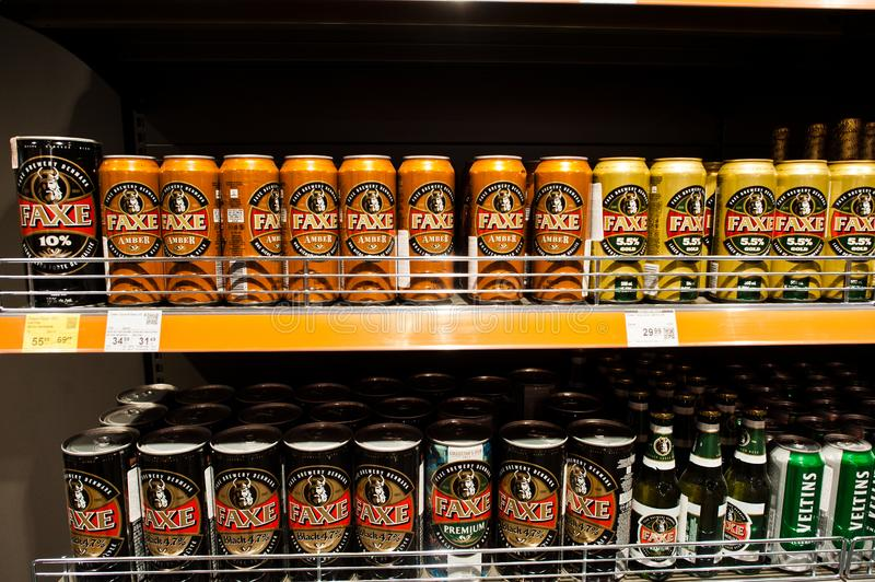 Kyiv, Ukraine - December 19, 2018: Faxe beer cans on shelves in a supermarket. Faxe Brewery is a Danish brewery located in the royalty free stock photo