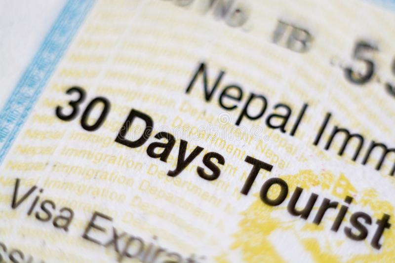 KYIV, UKRAINE - FEBRUARY 2019: close up of Nepal visa sticker in passport stock photo