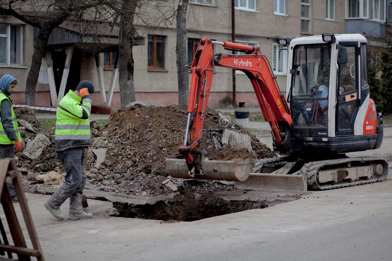 Kyiv, Ukraine - February 22, 2019: A group of road workers from public utilities in reflective special vests are discussing an stock images