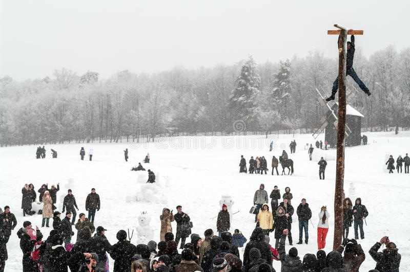 Maslenitsa Shrovetide festivities in around the city. Traditional fun at Shrovetide. Heavy snowfall. royalty free stock image