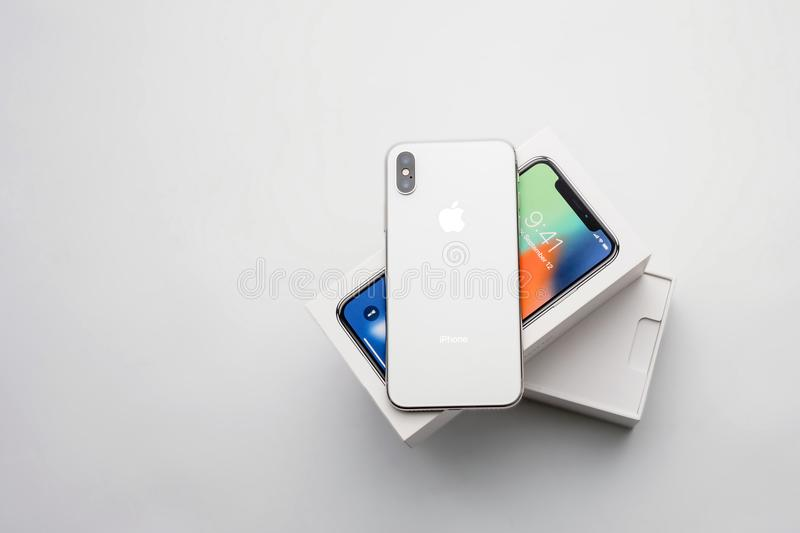 KYIV, UKRAINE - 26 JANUARY, 2018: New Iphone X smartphone model close up. Newest Apple Iphone 10 mobile phone device on white bran stock photography