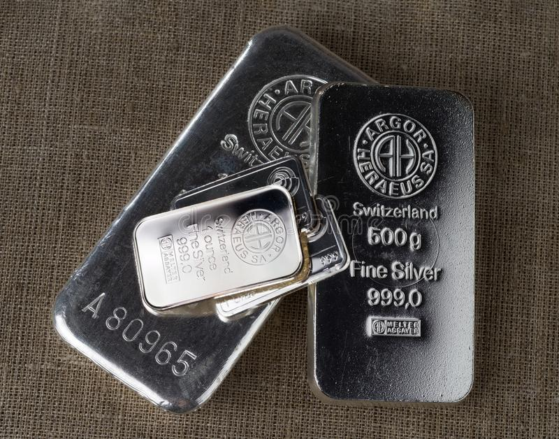 Several silver bars of different weights produced at the Swiss factory Argor-Heraeus and other manufacturers stock image