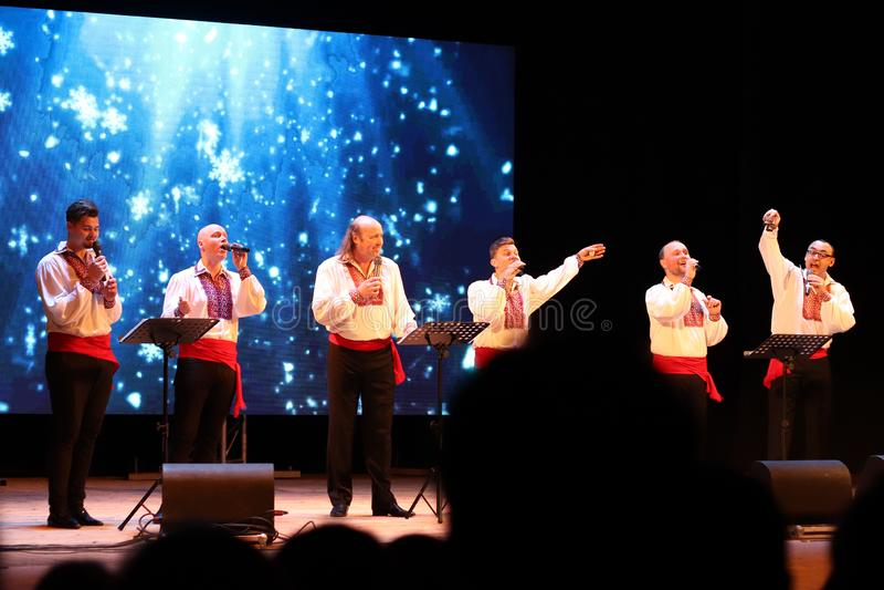 Kyiv, Ukraine - January 16, 2019. Ukrainian jazz and folk acapella singers band Mansound. Sextet. Christmas concert in the hall of royalty free stock photography