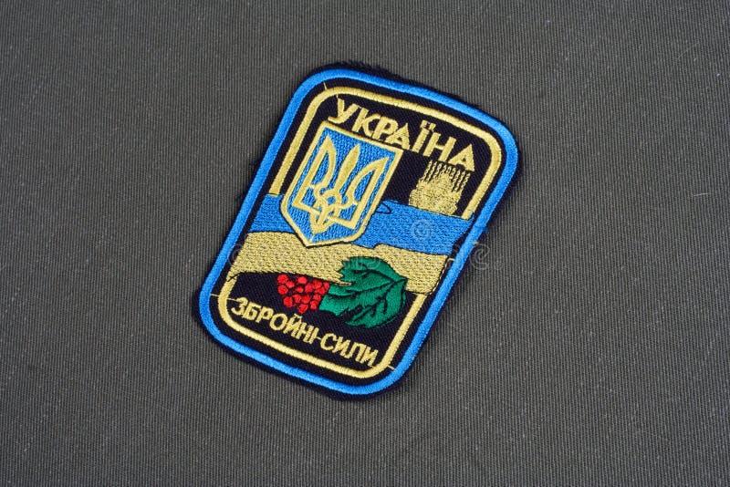 KYIV, UKRAINE - July, 16, 2015. Ukraine Army uniform badge on camouflaged uniform. KYIV, UKRAINE - July, 16, 2015. Ukraine Army uniform badge royalty free stock photography