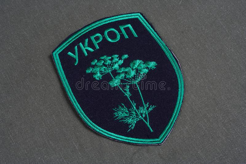 KYIV, UKRAINE - July, 16, 2015. Ukraine Army unofficial uniform badge 'UKROP ' on camouflaged uniform. KYIV, UKRAINE - July, 16, 2015. Ukraine Army unofficial royalty free stock photography