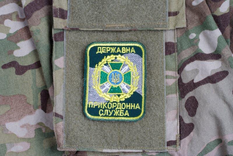 KYIV, UKRAINE - July, 16, 2015. Ukraine Border Guard uniform badge on camouflaged uniform. KYIV, UKRAINE - July, 16, 2015. Ukraine Border Guard uniform badge stock images