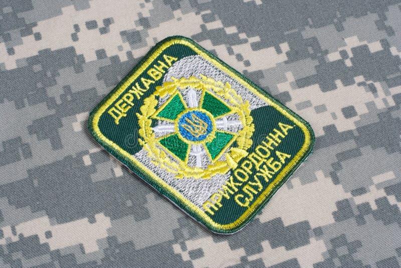 KYIV, UKRAINE - July, 16, 2015. Ukraine Border Guard uniform badge on camouflaged uniform. KYIV, UKRAINE - July, 16, 2015. Ukraine Border Guard uniform badge royalty free stock images