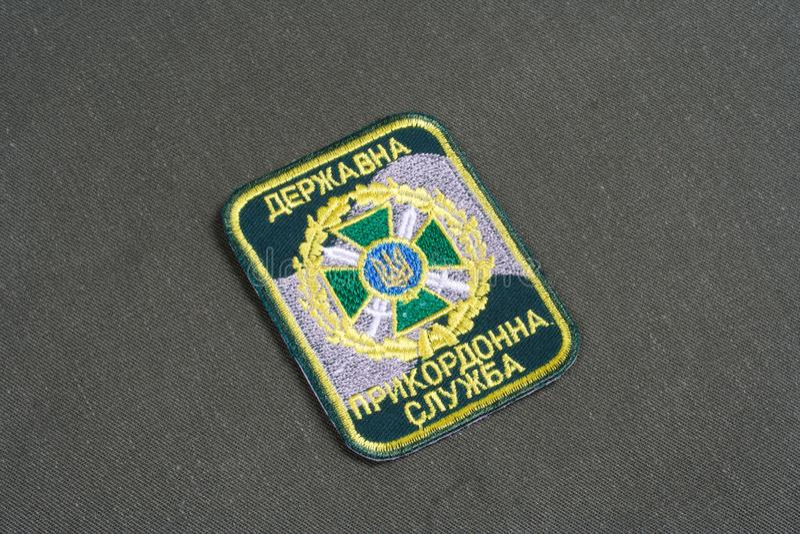 KYIV, UKRAINE - July, 16, 2015. Ukraine Border Guard uniform badge on camouflaged uniform. KYIV, UKRAINE - July, 16, 2015. Ukraine Border Guard uniform badge royalty free stock image