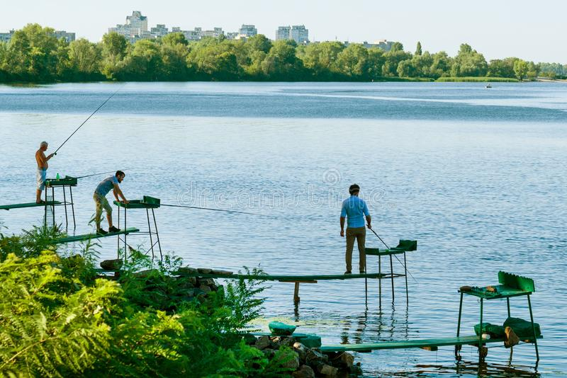 KYIV, UKRAINE. July 31. 2017. Relax in the city. Men are fishing on the river. stock photography