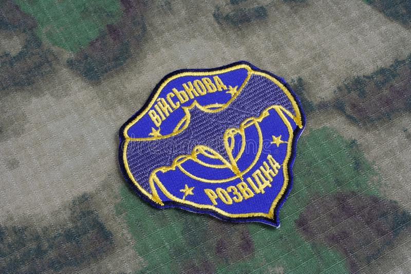 KYIV, UKRAINE - July, 16, 2015. Ukraine's military intelligence uniform badge on camouflaged uniform. KYIV, UKRAINE - July, 16, 2015. Ukraine's military royalty free stock photography