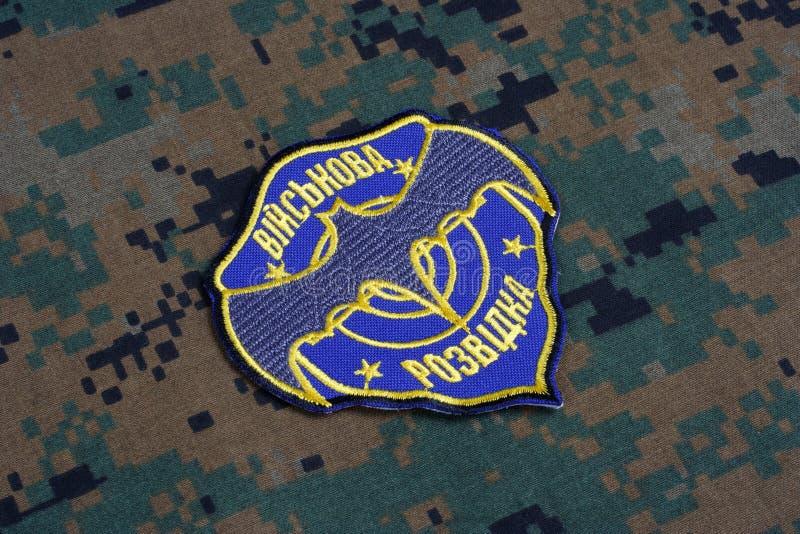 KYIV, UKRAINE - July, 16, 2015. Ukraine's military intelligence uniform badge on camouflaged uniform. KYIV, UKRAINE - July, 16, 2015. Ukraine's military stock photography