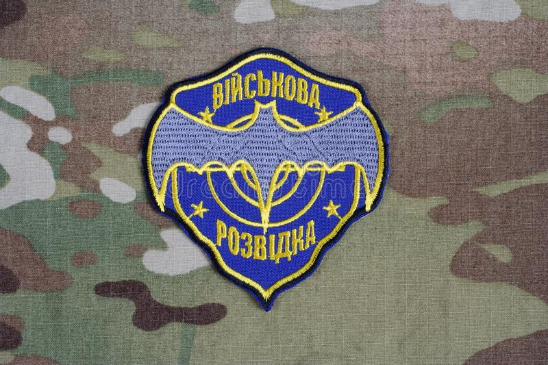 KYIV, UKRAINE - July, 16, 2015. Ukraine's military intelligence uniform badge on camouflaged uniform. KYIV, UKRAINE - July, 16, 2015. Ukraine's military stock photo