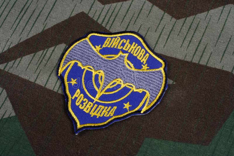KYIV, UKRAINE - July, 16, 2015. Ukraine's military intelligence uniform badge on camouflaged uniform. KYIV, UKRAINE - July, 16, 2015. Ukraine's military stock photos