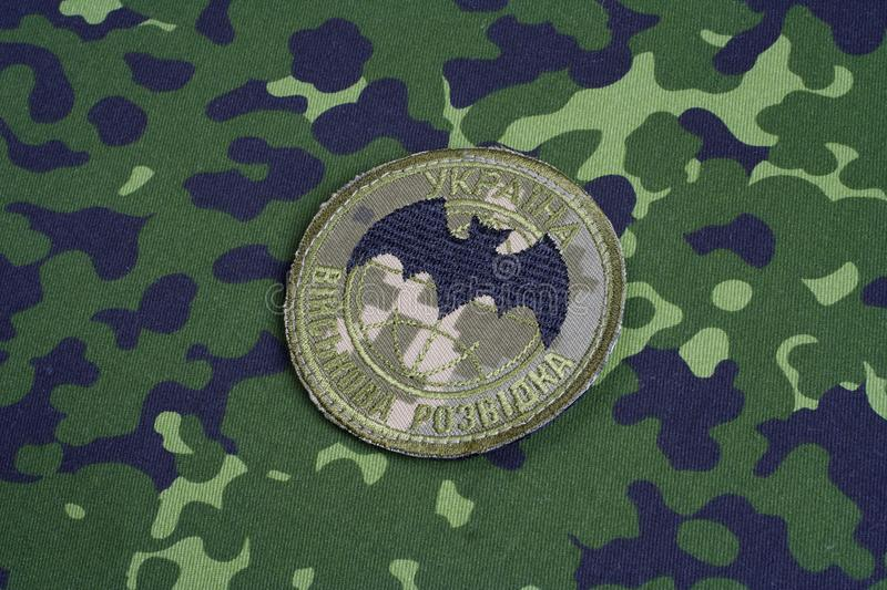KYIV, UKRAINE - July, 16, 2015. Ukraine`s military intelligence uniform badge. Background stock photo