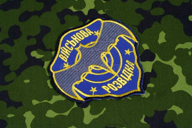 KYIV, UKRAINE - July, 16, 2015. Ukraine's military intelligence uniform badge. Background royalty free stock photo