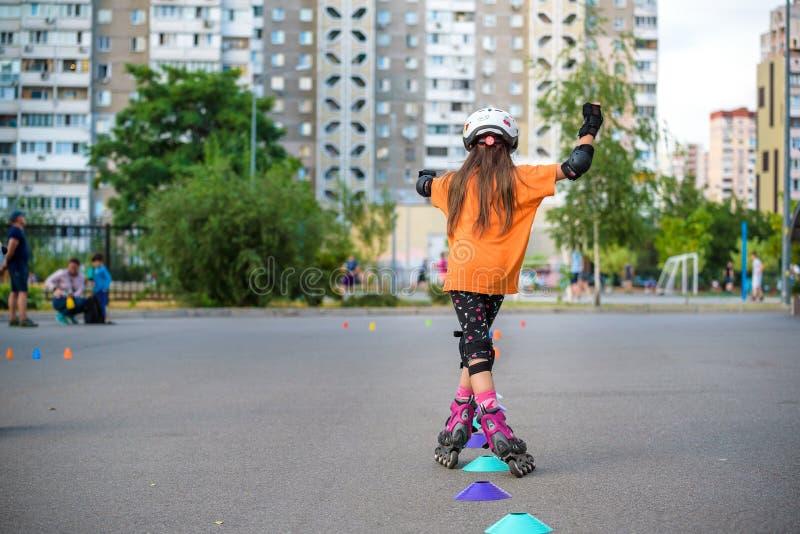 KYIV, UKRAINE JUNE 26, 2018: Attractive teenage girl roller skating on roller blades stock photos