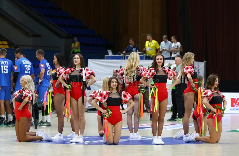 EHF EURO 2020 Qualifiers handball game Ukraine v Denmark. KYIV, UKRAINE - JUNE 12, 2019: Cheerleaders team Red Foxes perform during the EHF EURO 2020 Qualifiers stock photography
