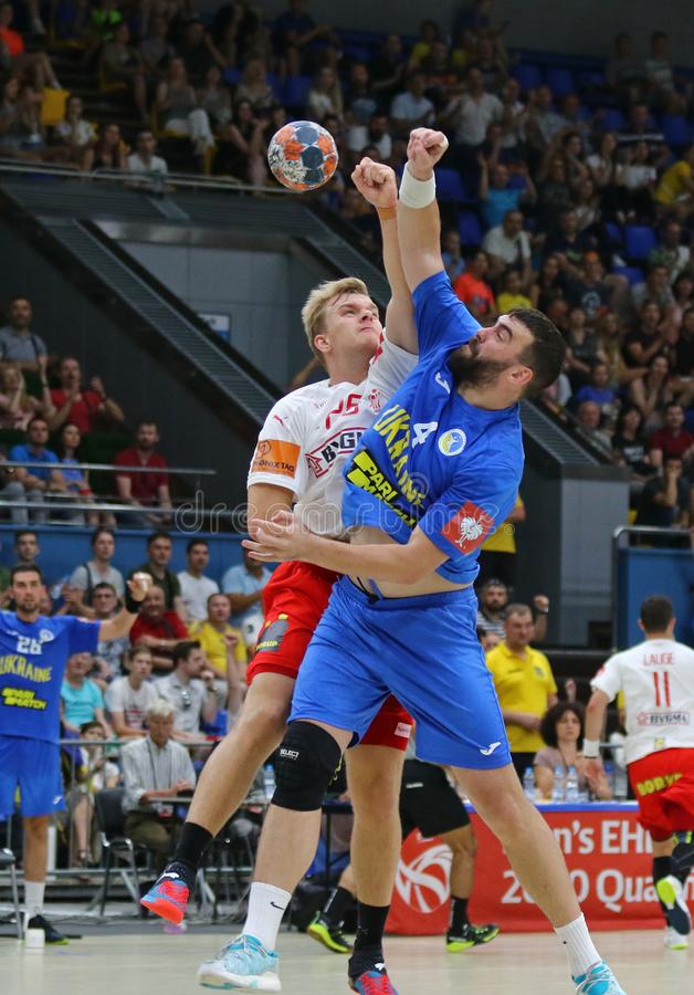 EHF EURO 2020 Qualifiers handball game Ukraine v Denmark. KYIV, UKRAINE - JUNE 12, 2019: Johan a Plogv HANSEN of Denmark L fights for a ball with Evgeniy royalty free stock photo