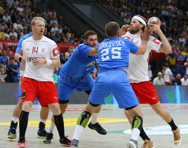 EHF EURO 2020 Qualifiers handball game Ukraine v Denmark. KYIV, UKRAINE - JUNE 12, 2019: Mikkel HANSEN of Denmark R attacks during the EHF EURO 2020 Qualifiers stock image