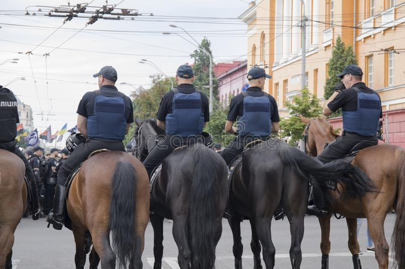Kyiv, Ukraine - June 23, 2019. Mounted police in the city. Kyiv, Ukraine - June 23, 2019. Mounted police on the road in the city stock photos