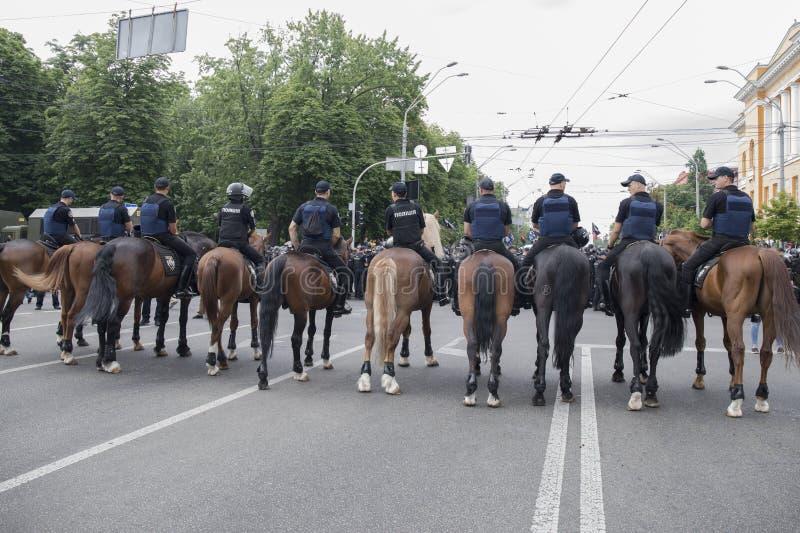 Kyiv, Ukraine - June 23, 2019. Mounted police in the city. Kyiv, Ukraine - June 23, 2019. Mounted police on the road in the city stock photo