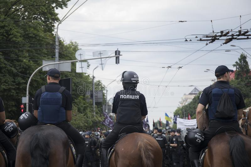Kyiv, Ukraine - June 23, 2019. Mounted police in the city. Kyiv, Ukraine - June 23, 2019. Mounted police on the road in the city stock image