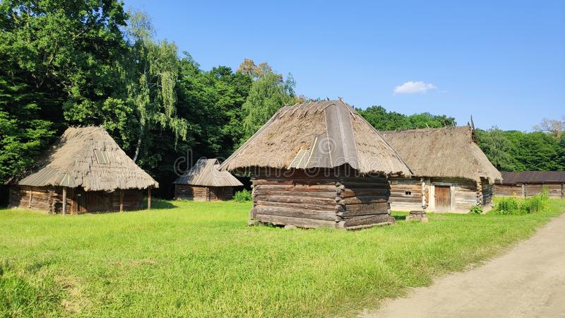 Kyiv, Ukraine - June 12, 2019: Old wooden huts with straw roof. Traditional Ukrainian village of the beginning of the 20th century stock photo