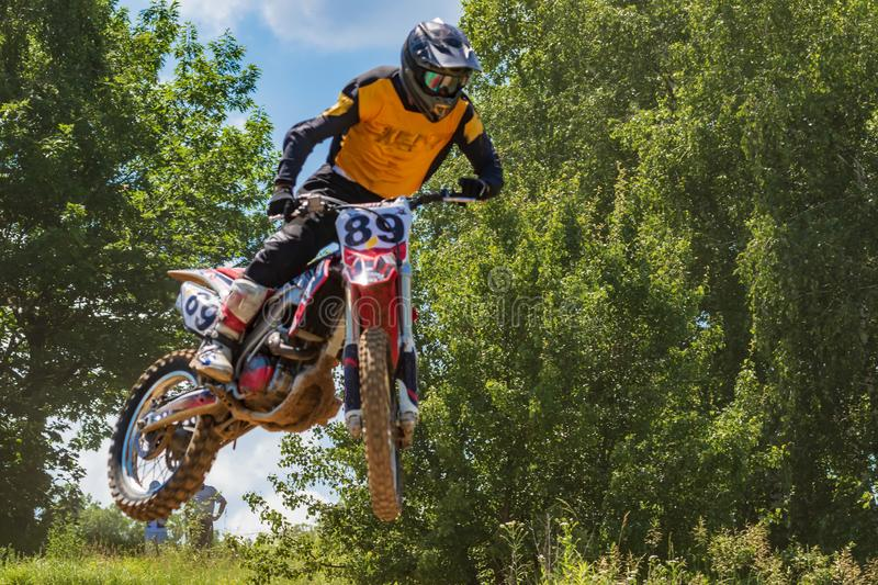 Kyiv, Ukraine - June 9, 2019: The open championship of the Goloseevskiy district. Motocross. The athlete on a motorcycle jumps royalty free stock photos