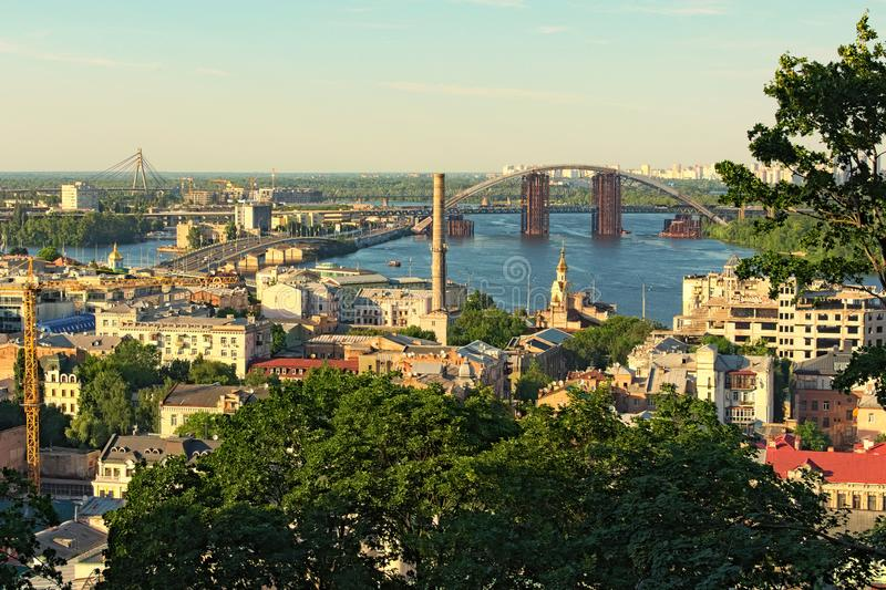 Stunning landscape view of ancient Podil neighborhood. River Dnipro with several bridges at the background royalty free stock image