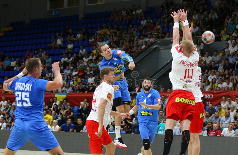 EHF EURO 2020 Qualifiers handball game Ukraine v Denmark. KYIV, UKRAINE - JUNE 12, 2019: Ukrainian players in Blue attack during the EHF EURO 2020 Qualifiers stock image