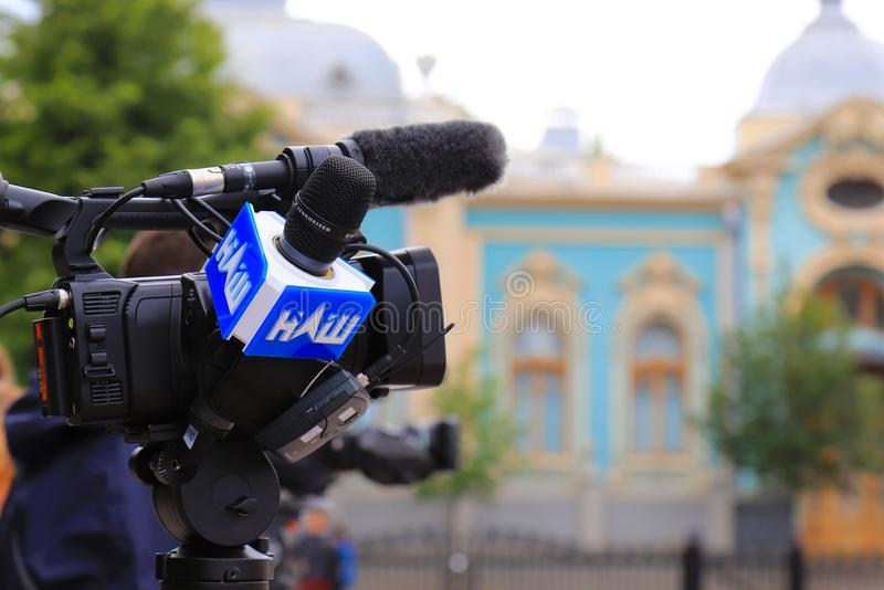 Kyiv, Ukraine, 28 06 2019. Logo of the Ukrainian opposition TV channel Nash is drawn on the microphone and equipment for. Television filming near the Ukrainian royalty free stock photo