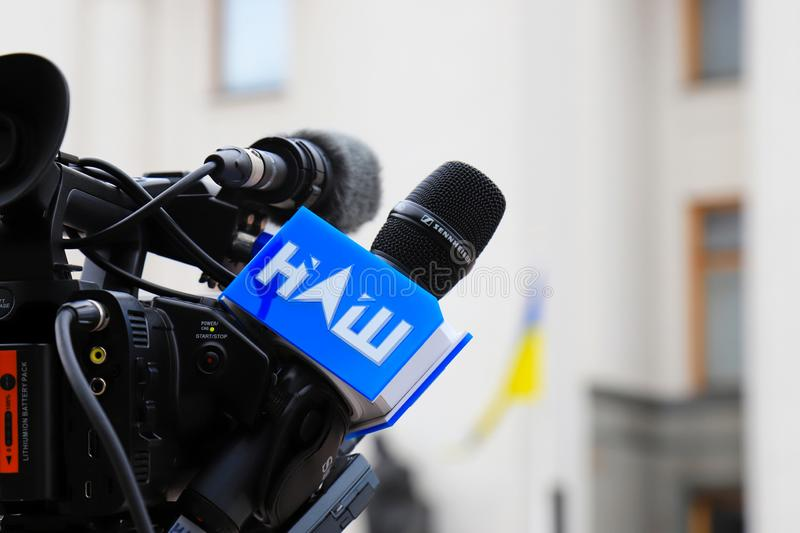 Kyiv, Ukraine, 28 06 2019. Logo of the Ukrainian opposition TV channel Nash is drawn on the microphone and equipment for. Television filming near the parliament royalty free stock photos