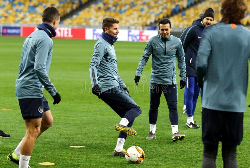 UEFA Europa League. Dynamo Kyiv v Chelsea. Pre-match training. KYIV, UKRAINE - MARCH 13, 2019: Chelsea players run on the pitch of NSC Olimpiyskyi stadium in stock photography