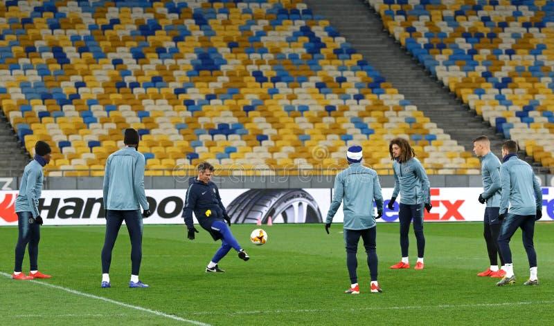 UEFA Europa League. Dynamo Kyiv v Chelsea. Pre-match training. KYIV, UKRAINE - MARCH 13, 2019: Chelsea players run on the pitch of NSC Olimpiyskyi stadium in stock photos