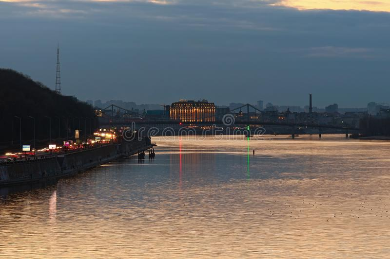 Stunning evening landscape of the Pedestrian bridge over Dnipro River stock photography