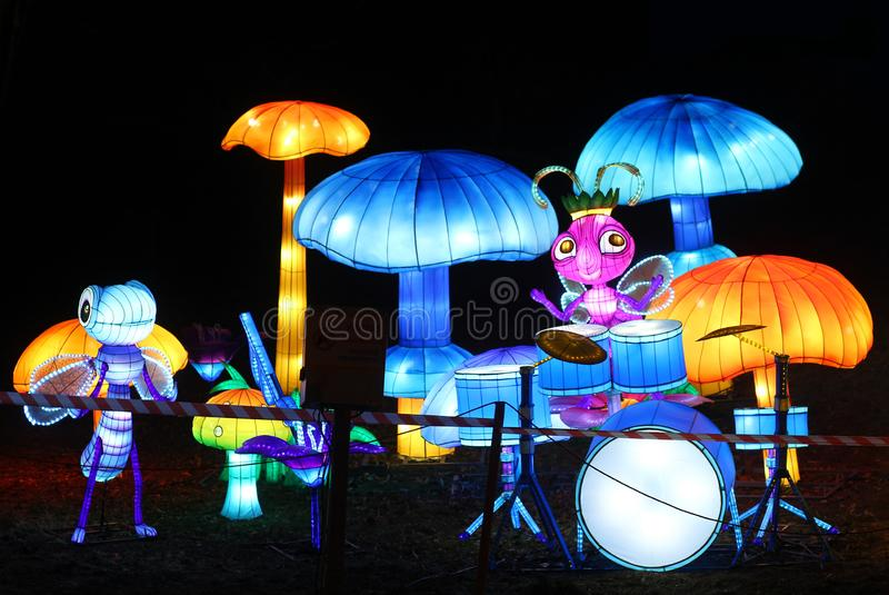 Traditional chinese lanterns festival. Cartoon drumming insects and giant mushrooms stock images
