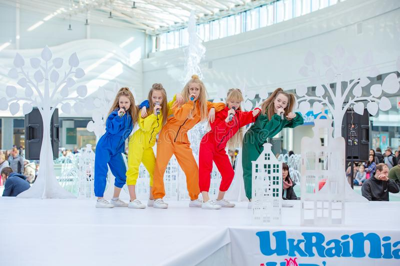 Kyiv, Ukraine March 03.2019. UKFW. Ukrainian Kids Fashion Day. A group of little girls singing or performing on stage stock photography